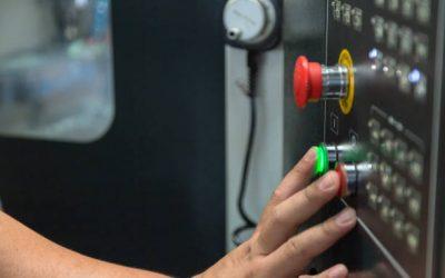 Technician press push button for starting machine